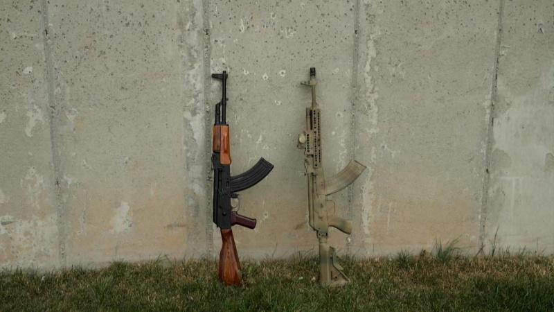 2 AK against a cement wall compressed